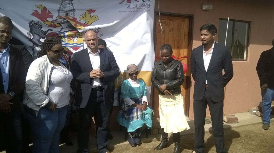 From the right, Mayor Cllr Afzul Rehman with the Manager in the Office of the Mayor, Ms Nomusa Mtshali and sitting down is Gogo Noboli Martha Nkambule who was handed over the house by Mayor Rehman.