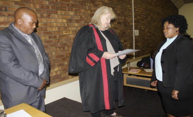 Cllr F.A Malinga swearing under oath in front of the Speaker and the magistrate