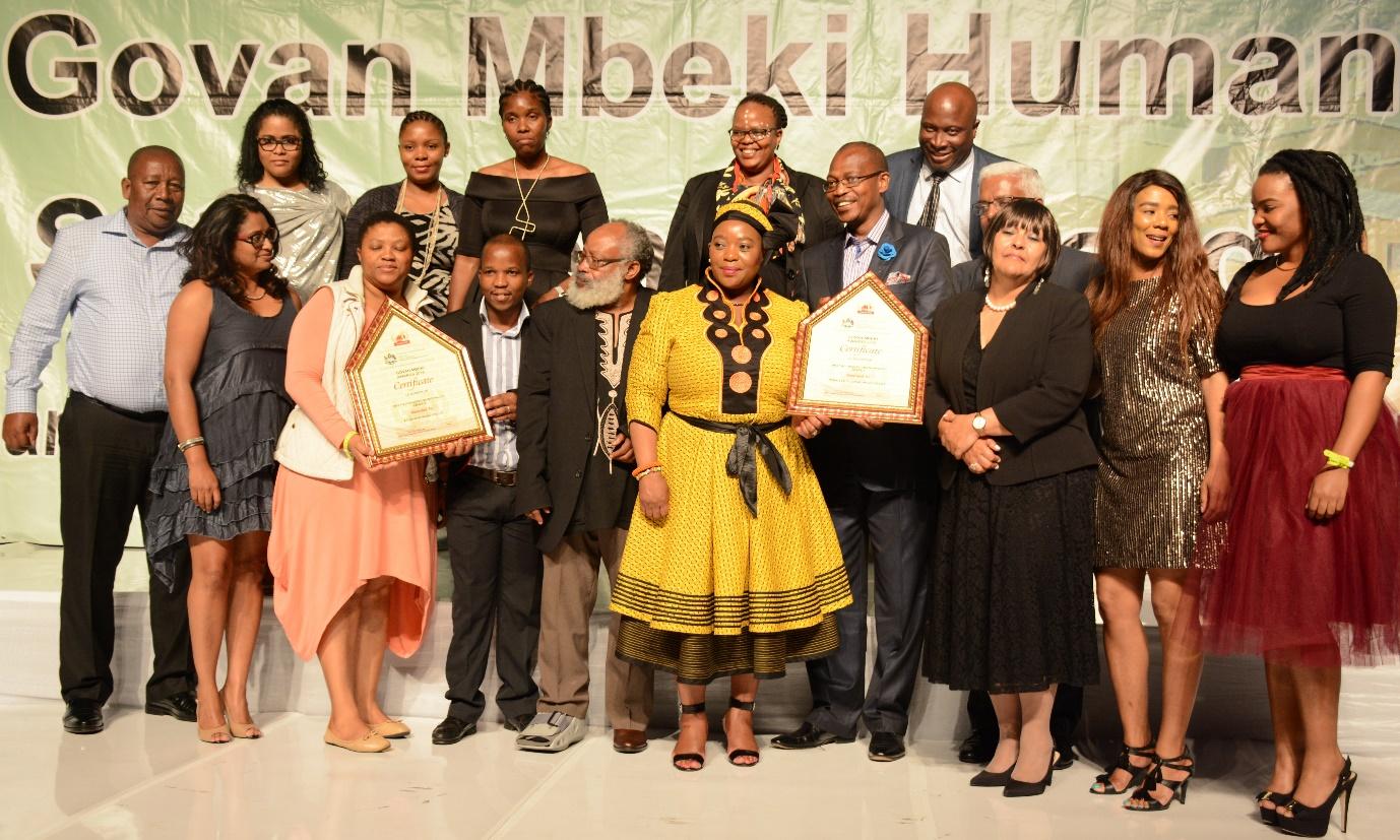 MEC Nomusa Dube- Ncube hands the award to Mayor Makhosini Nkosi