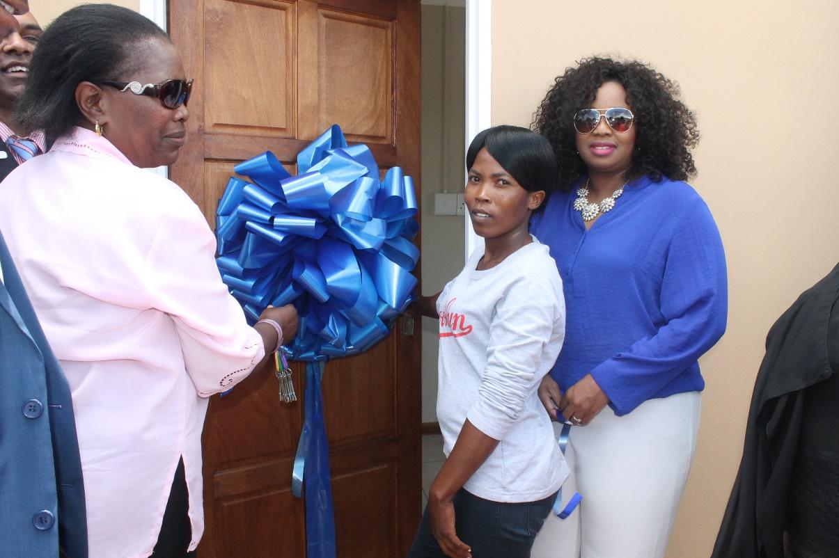 Seen in the picture is Deputy Mayor Cllr Dudu Sibiya and Standard bank Public Sector Head Mrs. Nelly Mkhize and beneficiary Zanele Ndlovu  of Ezibayeni