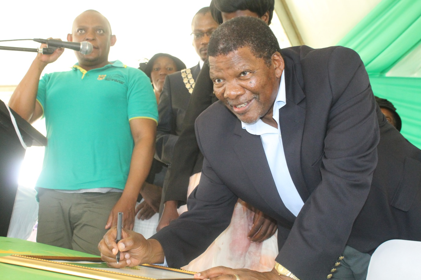 Minister Gugile signing a Land Use Rights certificates
