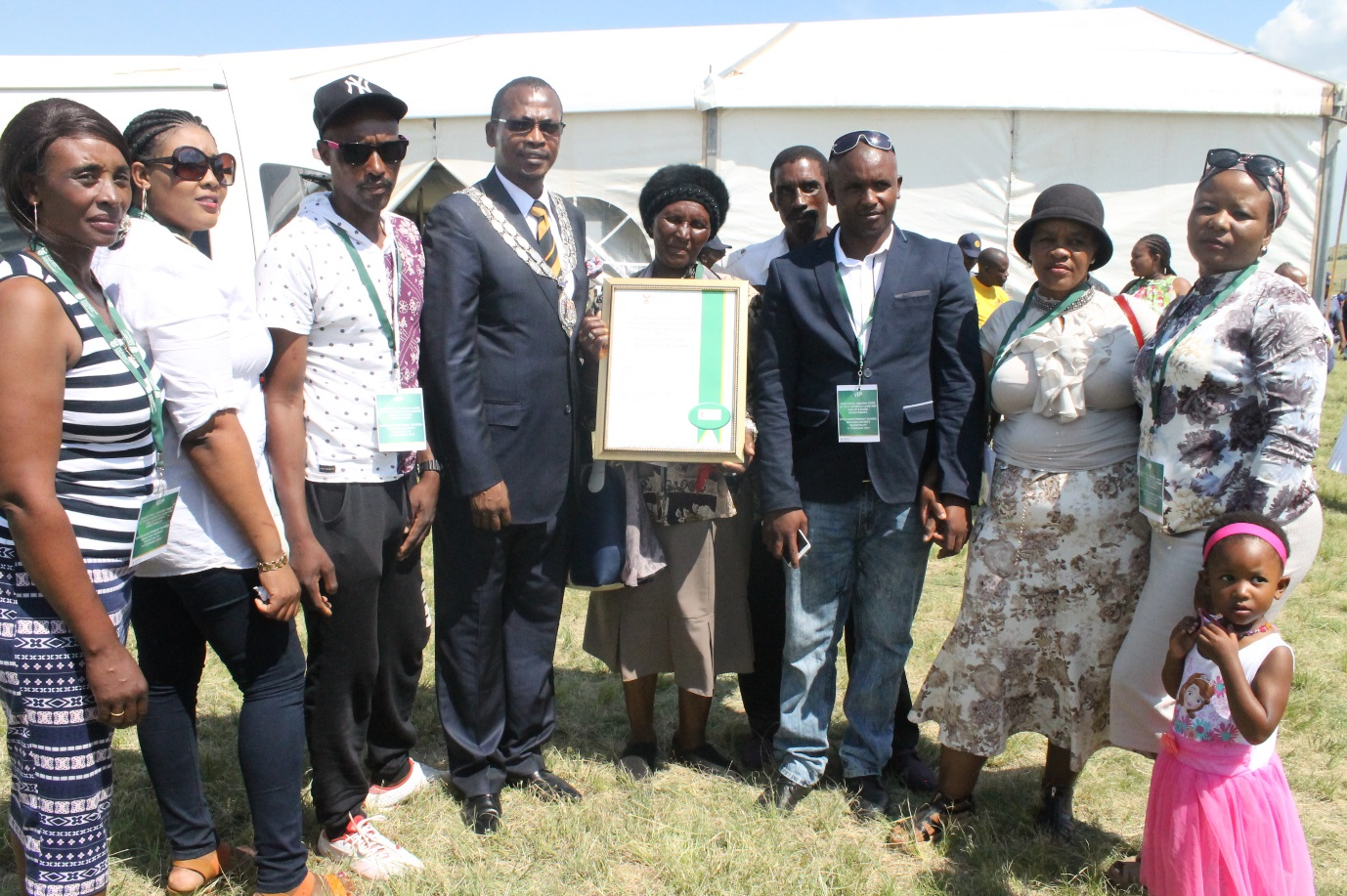 Beneficiary Gogo Shabalala from Normandien and her family with Newcastle Mayor Makhosini Nkosi