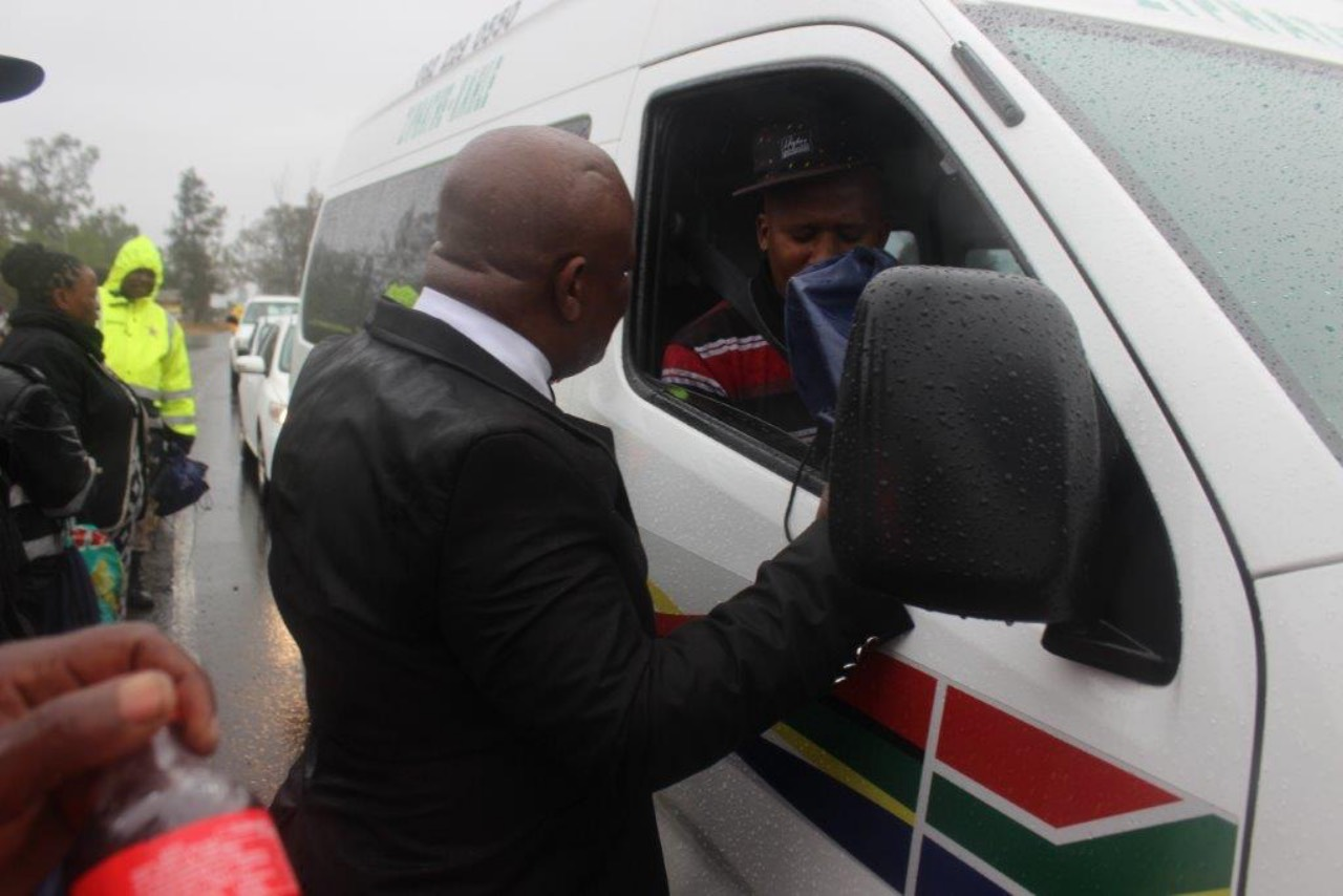 Dr. P.D Thabethe engaging with taxi drivers