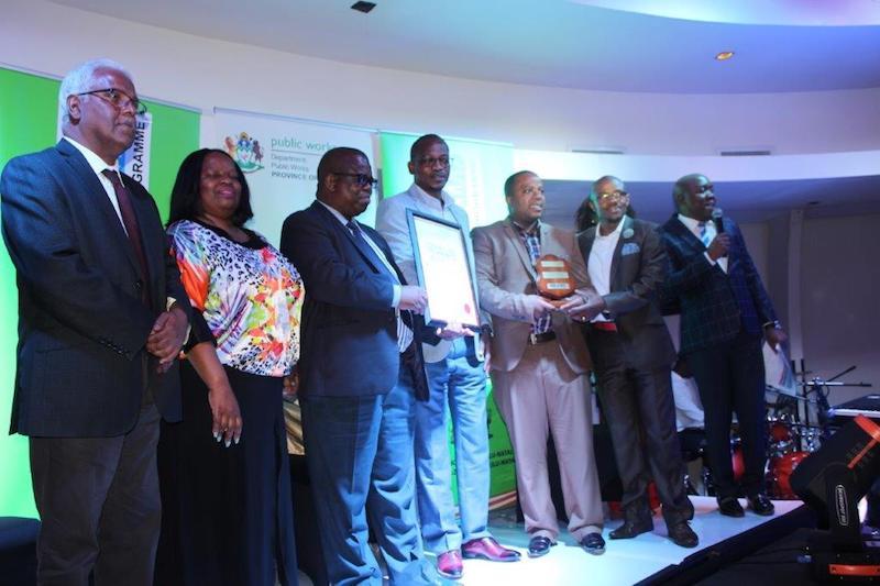 Newcastle Mayor Makhosini Nkosi and his team receiving the award from MEC of public works Ravi Pillai